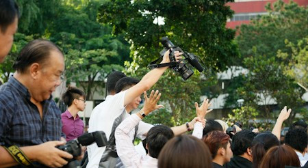 Kong Hee supporters attempt to block camera men at Subordinate Courts
