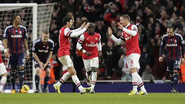 Podolski nets the winner.