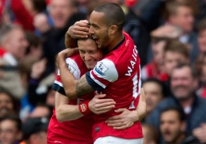 Rosicky and Walcott celebrates only to be undone by Sagna.