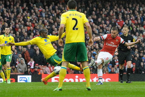 Podolski fires the third from the edge.