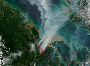 Winds carry smoke from hotspots in Sumatra to Malaysia and Singapore.