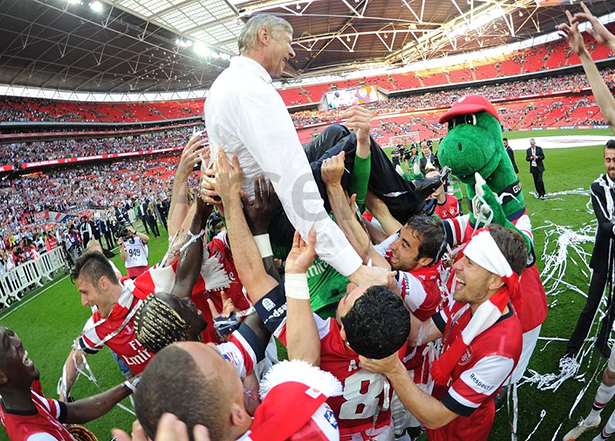 "The players lift a long suffering Wenger. ""This is for the manager and the fans"" - Ramsey."